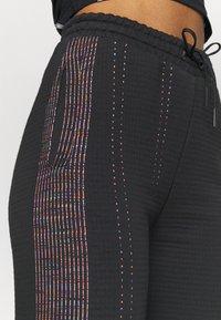 Nike Performance - PANT - Tracksuit bottoms - black - 4