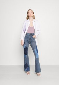 BDG Urban Outfitters - RIP AND REPAIR - Flared jeans - mid vintage - 1