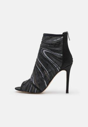 ABENDANI - Ankle cuff sandals - black