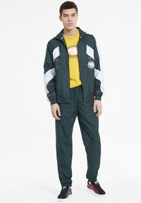 Puma - X THE HUNDREDS - Tracksuit bottoms - ponderosa pine