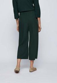 BOSS - Trousers - open green - 2