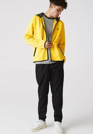 Sweat à capuche zippé - jaune / vert kaki