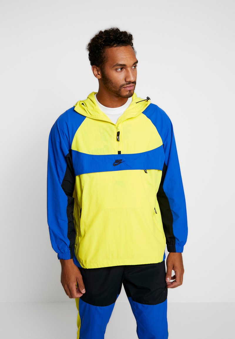 Nike Sportswear - RE-ISSUE - Windbreakers - dynamic yellow/game royal/black