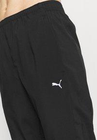 Puma - RUN TAPERED PANT - Pantalones deportivos - black - 4