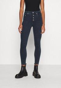 Calvin Klein Jeans - HIGH RISE SUPER SKINNY - Jeans Skinny Fit - dark blue denim - 0
