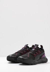Puma - EMBER TRL - Trail running shoes - black/purple/nrgy rose - 2
