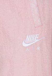 Nike Sportswear - AIR PANT - Pantalones deportivos - pink glaze/white - 5