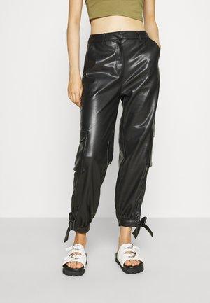 TIED HEM PANTS - Cargo trousers - black