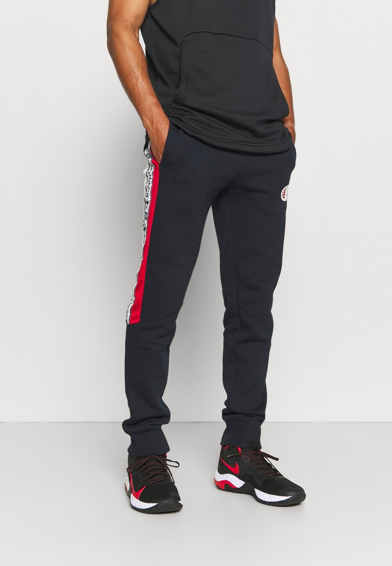 Champion - OFF COURT CUFF PANTS - Tracksuit bottoms - dark blue/white