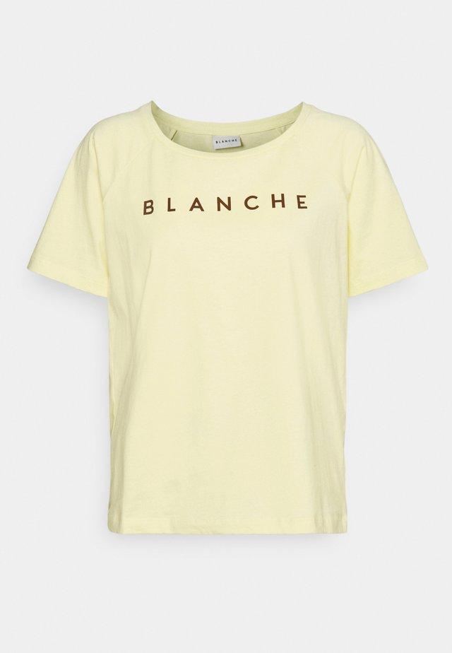 MAIN RAGLAN - T-shirt imprimé - sunshine