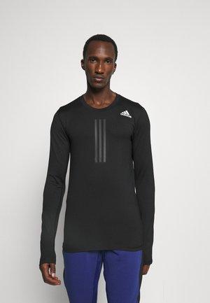 WARM DESIGNED TRAINING AEROREADY WARMING FITTED - Sports shirt - black