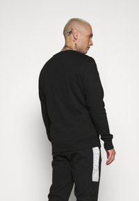 Jack & Jones - JCOBONDS TRACKSUIT SET - Sweatshirt - black - 3