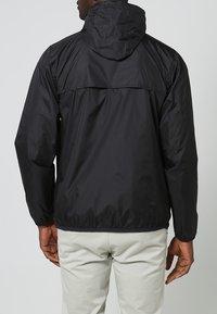 K-Way - LE VRAI CLAUDE UNISEX - Waterproof jacket - black - 3