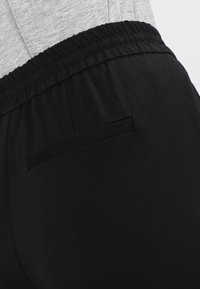 Vero Moda - VMEVA LOOSE STRING PANTS - Bukser - black