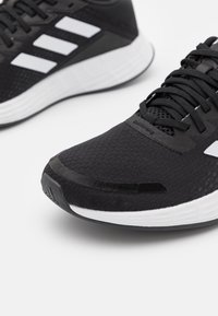 adidas Performance - DURAMO - Juoksukenkä/neutraalit - core black/footwear white/carbon - 5