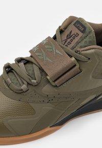 Reebok - LEGACY LIFTER II - Sports shoes - army green green/core black - 5