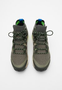 adidas Performance - FREE HIKER BOOST PRIMEKNIT SHOES - Hiking shoes - legend green/core black/sigal green - 3