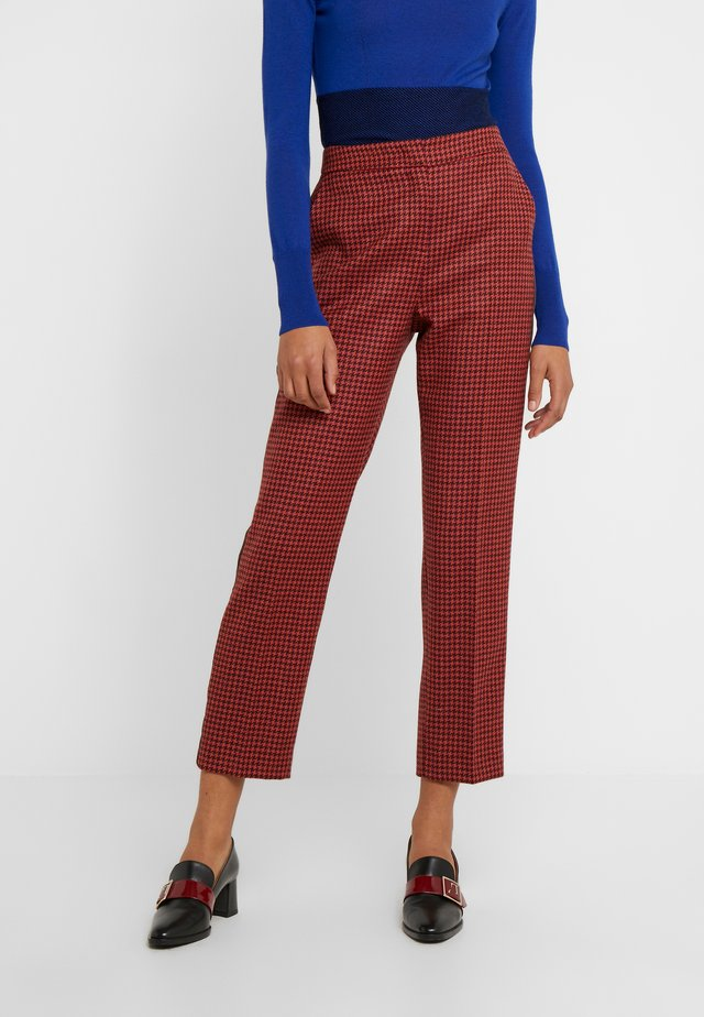INGRID - Trousers - orange/pink