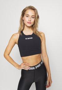 P.E Nation - RACING LINE SPORTS BRA - Medium support sports bra - black - 0