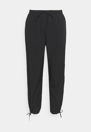 TIE CUFF JOGGERS - Tracksuit bottoms - black