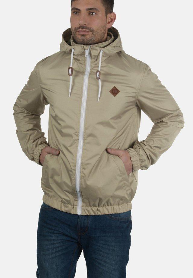 MIKRAS - Training jacket - beige