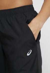 ASICS - PANT - Tracksuit bottoms - performance black - 4