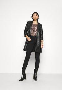Liu Jo Jeans - RAMPY - Jeans Skinny Fit - black ribbon - 1