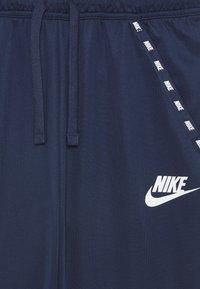 Nike Sportswear - POLY - Pantalones deportivos - midnight navy/game royal - 2