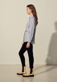 sandro - MADDLY - Button-down blouse - marine/ecru - 1