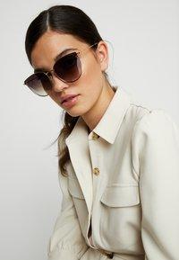 McQ Alexander McQueen - Sunglasses - gold-coloured/silver-coloured - 1