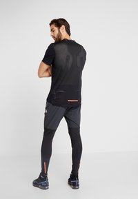 Nike Performance - WILD RUN HYBRID PANT - Træningsbukser - black/off noir/habanero red - 2