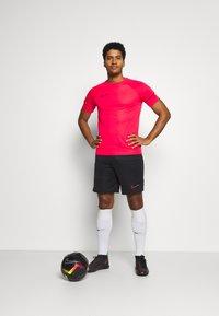 Nike Performance - ACADEMY 21 - Print T-shirt - siren red/black - 1