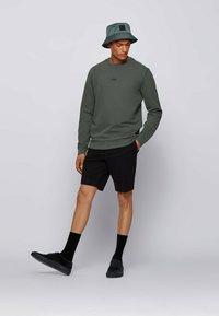 BOSS - WEEVO  - Sweatshirt - dark green - 1