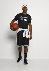 Nike Performance - DRY TEE - Print T-shirt - black - 1