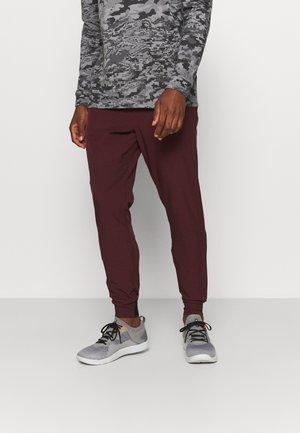 UNSTOPPABLE JOGGERS - Pantalon de survêtement - bordeaux