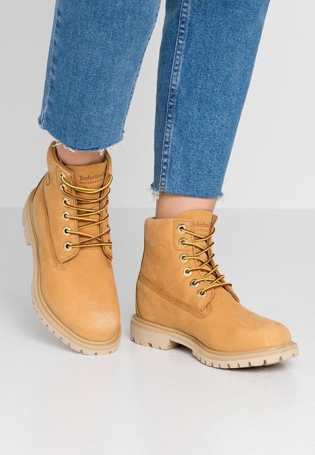PANINARA COLLARLESS  - Lace-up ankle boots - wheat