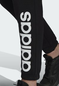 adidas Performance - Tracksuit bottoms - black - 4