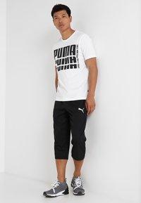 Puma - ACTIVE Pants - 3/4 sports trousers - puma black - 1