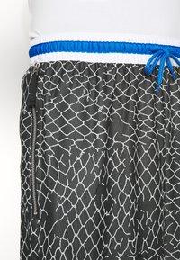 Nike Performance - SEASONAL DNA  - Sports shorts - black/light smoke grey - 5