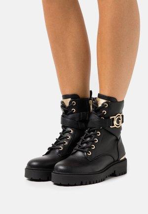 ODANNA - Lace-up ankle boots - black