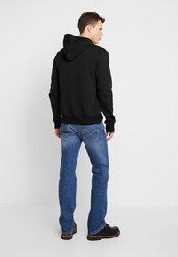 Diesel - LARKEE - Straight leg jeans - 0096E01 - 2