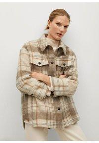 Mango - ROIBOS - Button-down blouse - ecru - 0