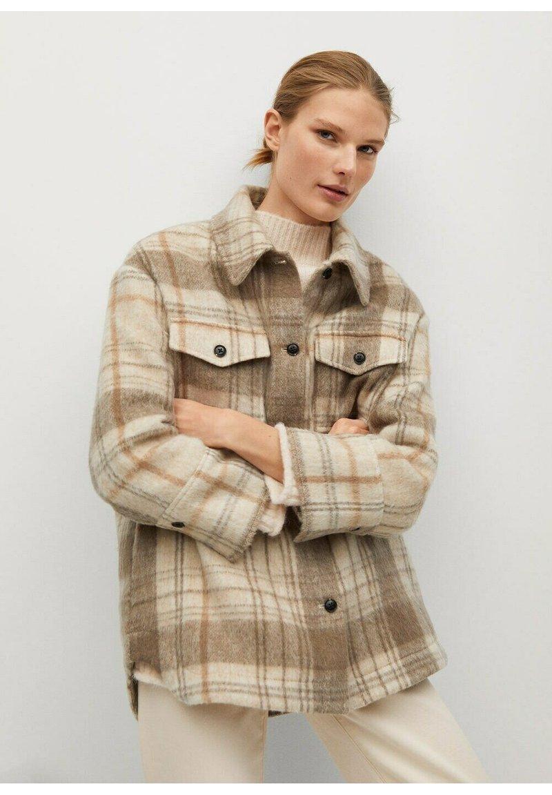 Mango - ROIBOS - Button-down blouse - ecru
