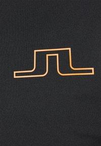 J.LINDEBERG - T-shirt sportiva - black - 2