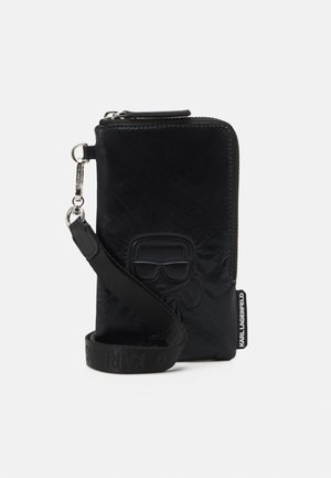IKONIK DPOUCH METALLIC - Phone case - black