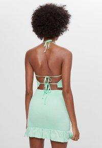 Bershka - MIT GUMMIZUG UND VOLANTS  - A-line skirt - green - 2