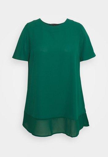 T-shirts med print - palm green