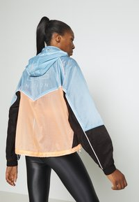 P.E Nation - AERIAL DROP JACKET - Training jacket - light blue