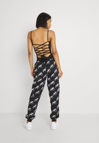 Missguided - PLAYBOY GRAFFIFTI OVERS - Tracksuit bottoms - black - 2