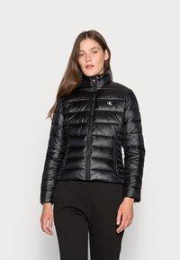 Calvin Klein Jeans - BACK LOGO ELASTIC MOTO JACKET - Winter jacket - black - 0